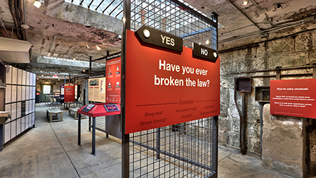"""Have you ever broken the law?"" sign at the entrance to the exhibit"